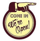 Come in, we are open! Sign with hand pointing finger