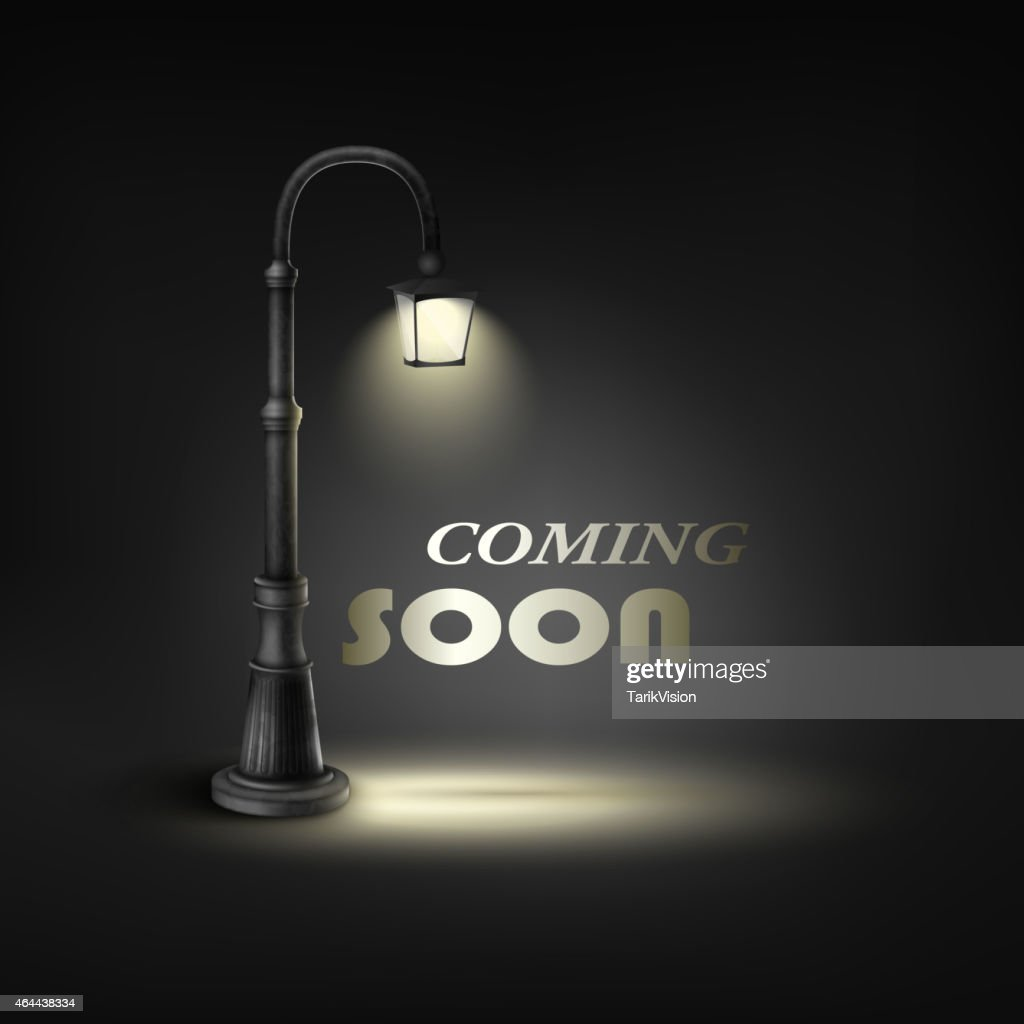 Coming Soon With Under Street Lamp.