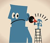 Communications between man and women, Businesswoman on ladder with megaphone (bullhorn) talking (speaking, scolding) to a man