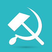 Communist star with hammer and sickle on white background.