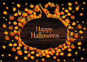 Composition of pumpkins. Halloween. Greeting card for a holiday or an invitation to a party. Empty space for text Vector on wooden background