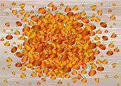 Composition of pumpkins. Halloween. Greeting card for a holiday or an invitation to a party. Empty space for text. Vector on wooden background.