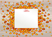 Composition of pumpkins. Halloween. Greeting card for a holiday or an invitation to a party. Empty space for text. Vector on wooden background