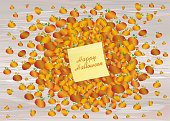Composition of pumpkins. Halloween. Greeting card for a holiday or an invitation to a party. Empty space for text. Vector on wooden background. Yellow sheet of paper for notes. Sticker.