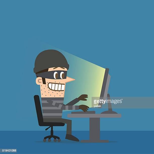 Computer hacker in the dark