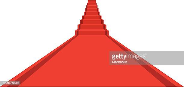Concept long red carpet with stairs ahead