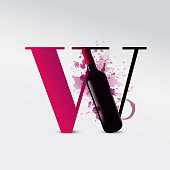 Concept with letter W and illustration of wine bottle. background spots and drops of wine. Idea for wine business promotion.