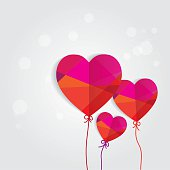 conceptual romantic card with colorful heart shaped papers