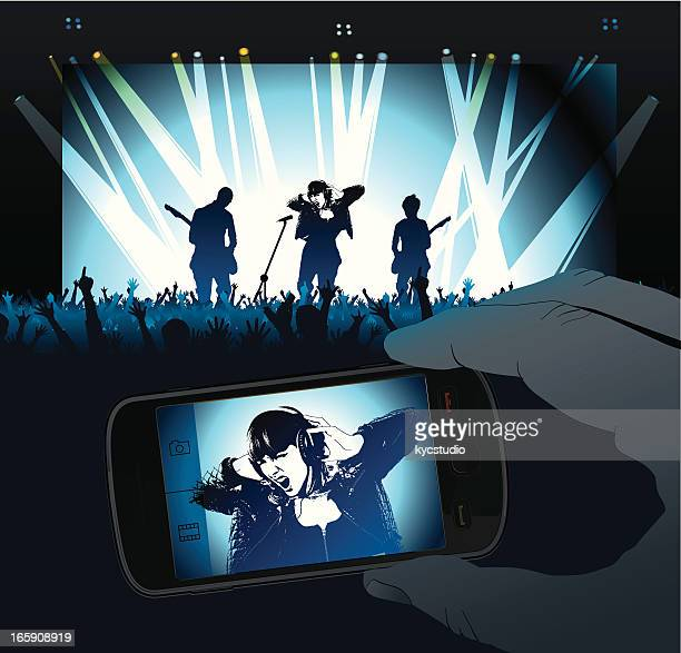 concert with rock singer projected in smartphone screen - interactivity stock illustrations, clip art, cartoons, & icons
