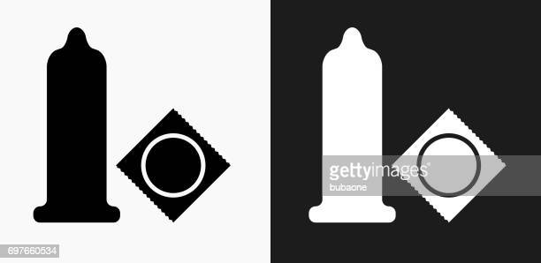 condom icon on black and white vector backgrounds - condom stock illustrations