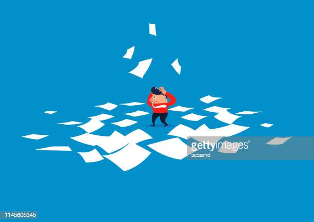 Confused businessman, businessman drowning in countless files
