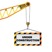 Construction crane holding sign