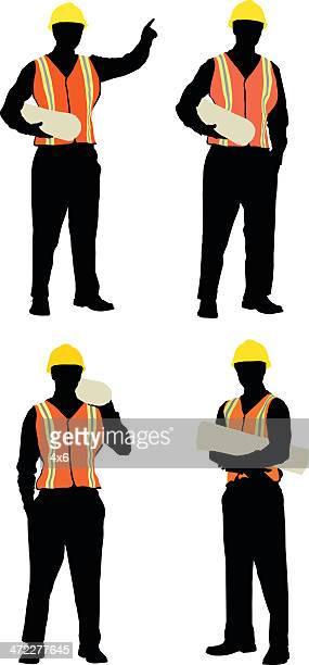 Construction foreman holding plans