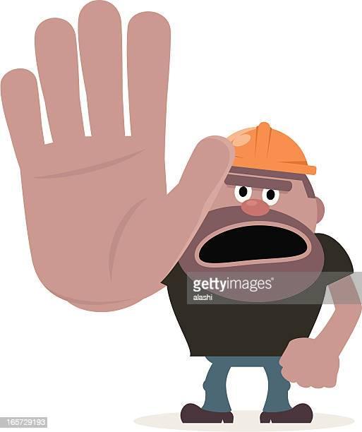 Construction Worker showing stop gesture