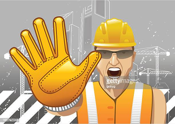 Construction worker showing stop