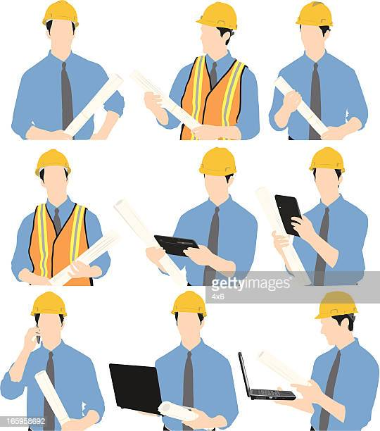 Construction worker with laptop and blueprint