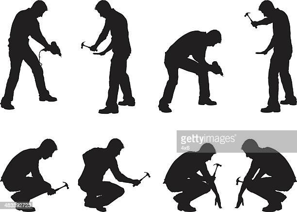 construction workers drilling and hammering - carpenter stock illustrations