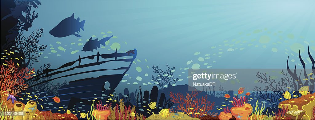 Coral reef with sharks and silhouette of sunken ship