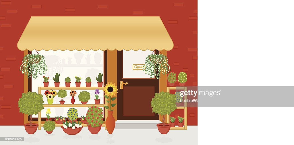 Cornerstone mom and pop flower shop with shrubs outside