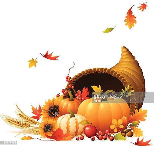 Cornucopia full of pumpkins, berrys, wheat and autumn leaves