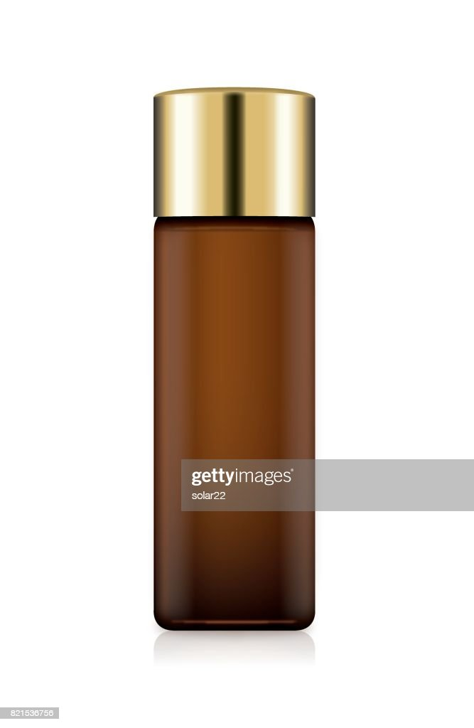 Cosmetic Bottle Amber color with gold cap isolated on white.