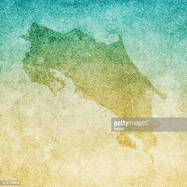 costa rica map on grunge canvas background - costa rica stock illustrations, clip art, cartoons, & icons