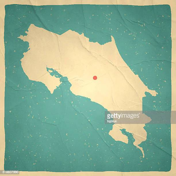 costa rica map on old paper - vintage texture - costa rica stock illustrations, clip art, cartoons, & icons