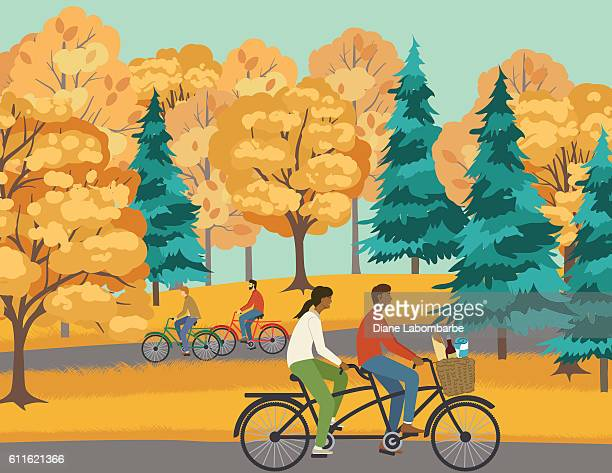 Couple Bicycling On A Path In The Park