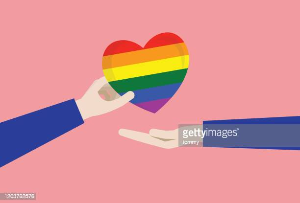 a couple gives a rainbow heart - homosexual couple stock illustrations