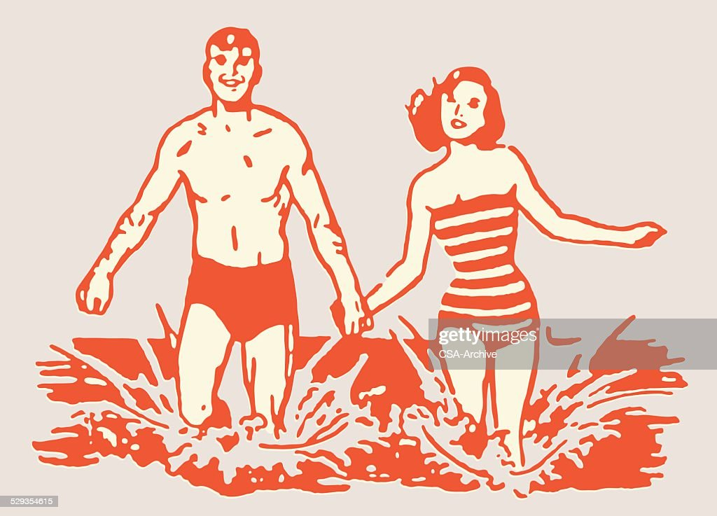Couple in Bathing Suits Running in Ocean Surf
