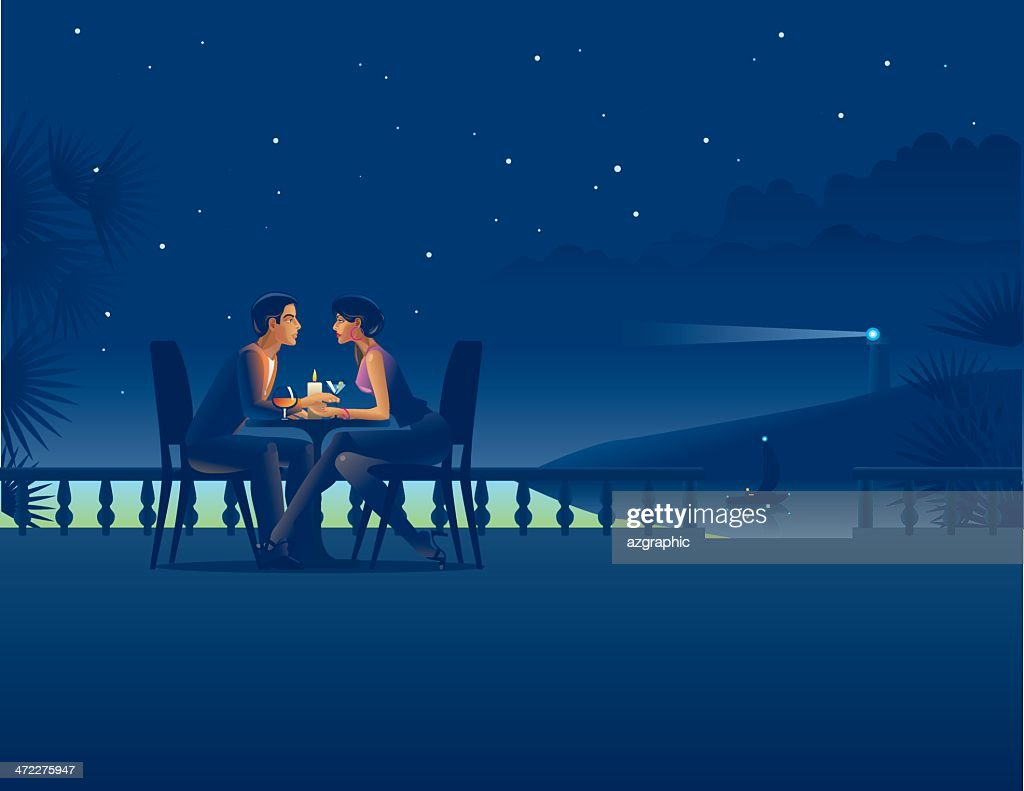 Couple in night coast cafe.