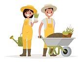 Couple of gardeners. Man with wheelbarrow of earth, a woman