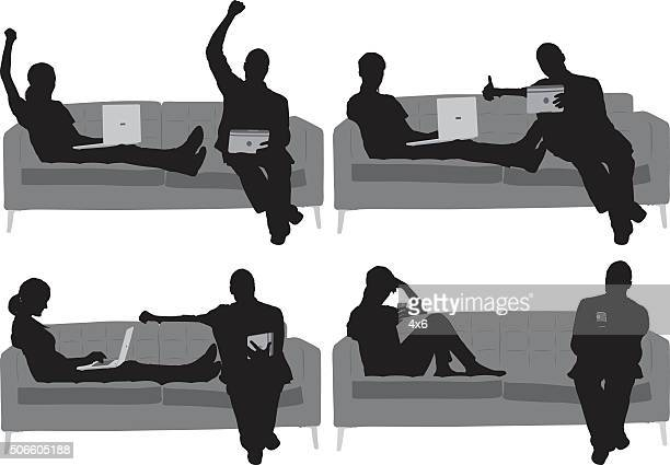 Couple on couch and in actions with laptop