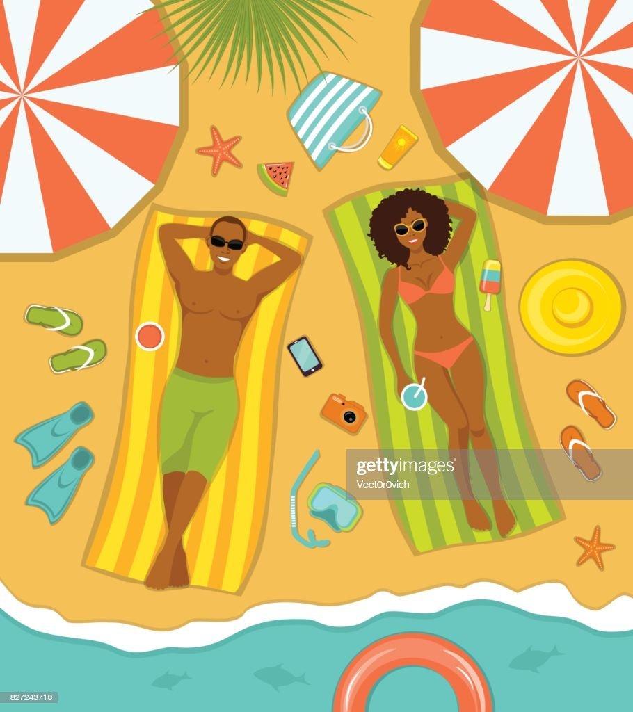 Couple on the beach top view. Man and Woman sunbathing on striped towels . Summer Time