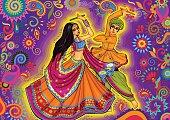 Couple playing Garba in Dandiya Night Navratri Dussehra festival