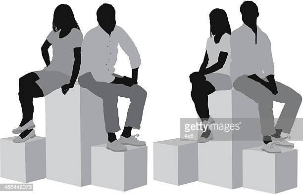 ilustraciones, imágenes clip art, dibujos animados e iconos de stock de pareja sentada en cajas - encuadre de cuerpo entero