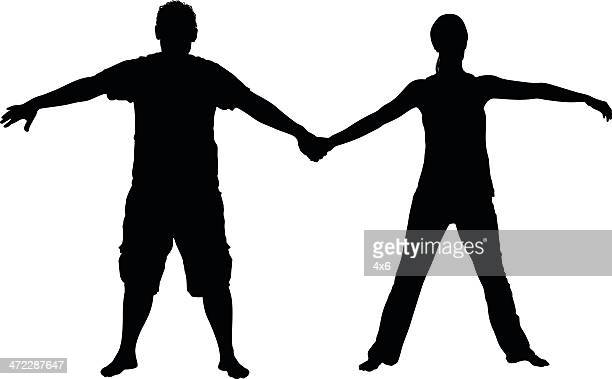 Couple standiing with holding hands
