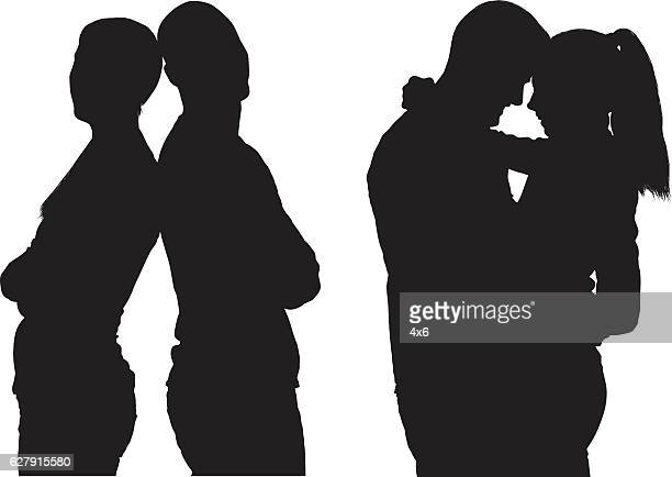 couple standing together - back to back stock illustrations, clip art, cartoons, & icons