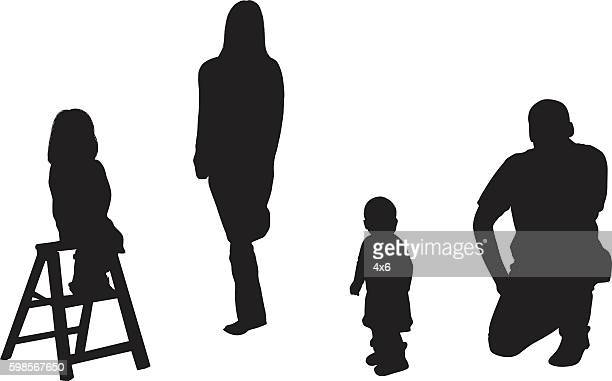 Couple standing with their children