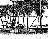 Couple Under Palapa at Beach