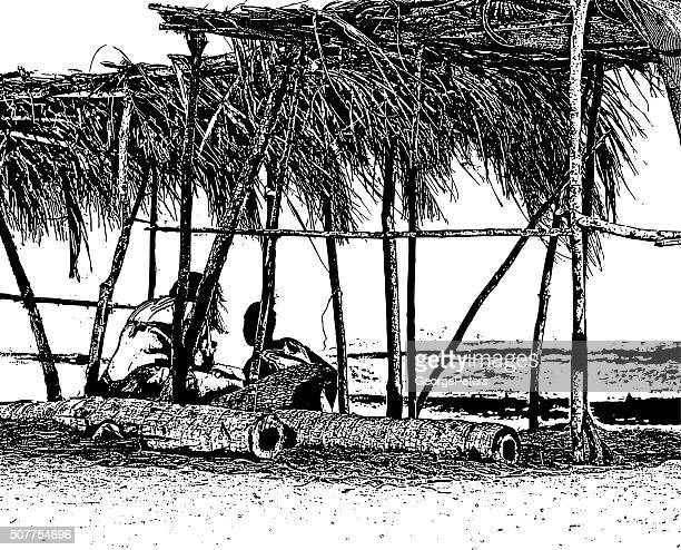 Couple Under Palapa at Beach