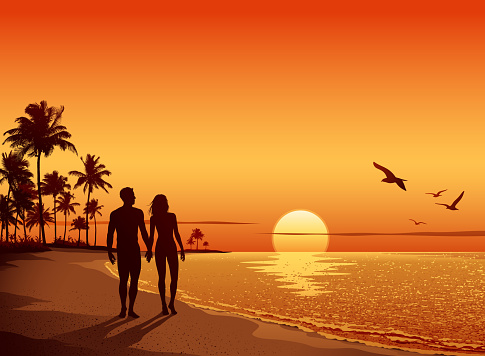 Couple walking on the Beach at Sunset - gettyimageskorea