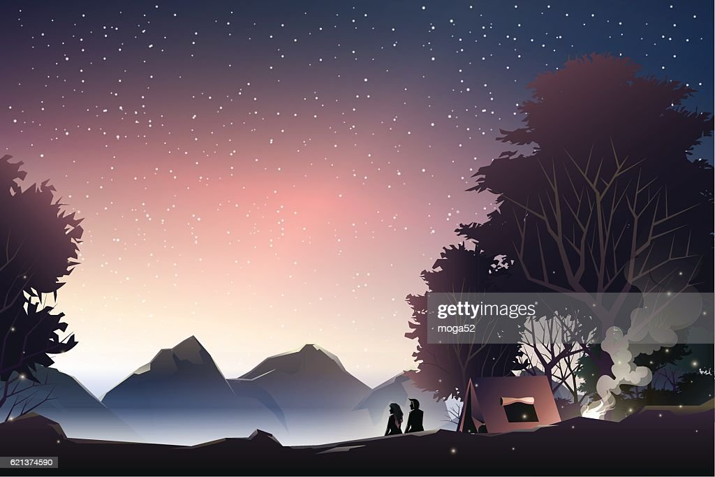 couple watch mountain at dusk