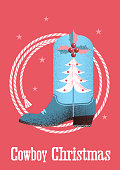 Cowboy christmas card background with western boot and lasso.
