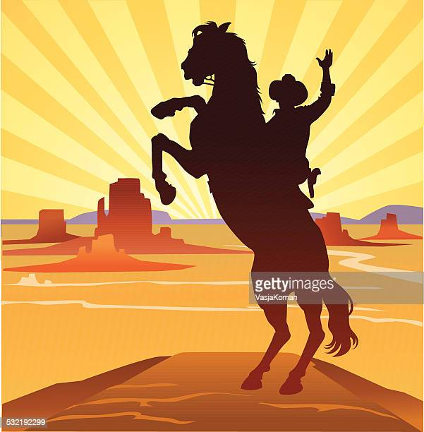 cowboy in wild west landscape - horse stock illustrations