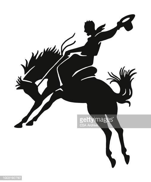 ilustrações de stock, clip art, desenhos animados e ícones de cowboy riding a horse - rodeio