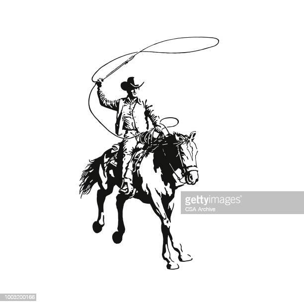 Cowboy With a Lasso Riding a Horse