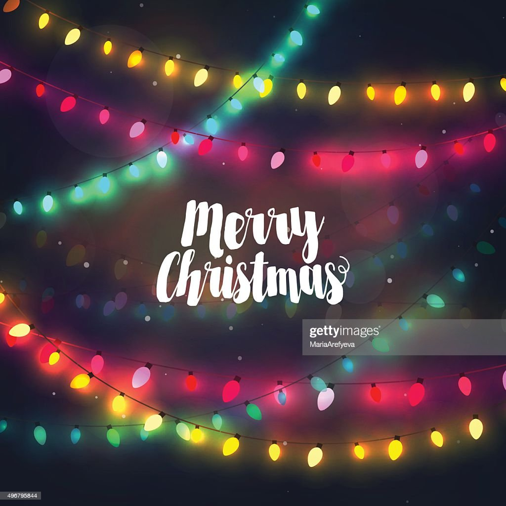 Cozy colorful Christmas lights garlands, greeting card with Merry Christmas