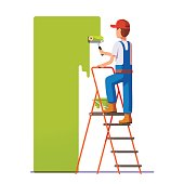 Craftsman painting white wall with roller