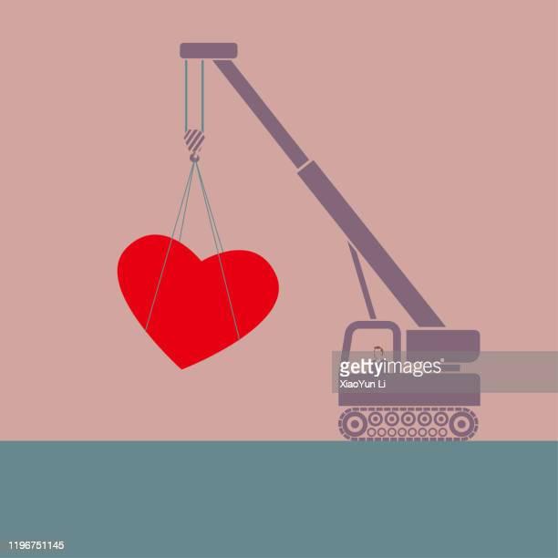 クレーンはハート型のシンボルを持ち上げます。 - 吊り上げる点のイラスト素材/クリップアート素材/マンガ素材/アイコン素材